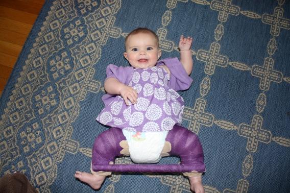 Hazel in her purple spica cast
